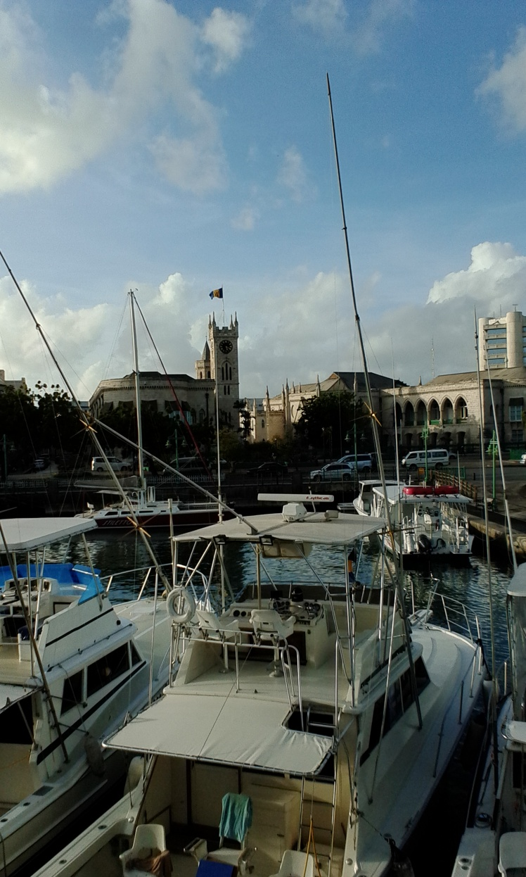Cruisers At Anchor, Barbados Careenage, With View Of Houses Of Parliament